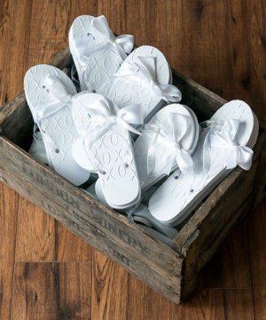 White XO Embossed Flip Flops